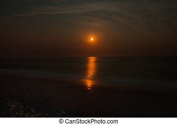 seascape with a red moon