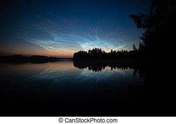 Night shining clouds over lake