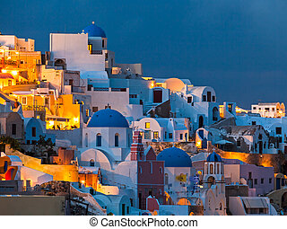 Night shot of houses and churches at Oia Santorini Greece