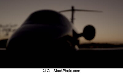 Night shot of parked private jet.