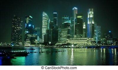 Night Singapore skyscrapers illuminated with lights