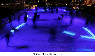 Night skating in outdoor ice park
