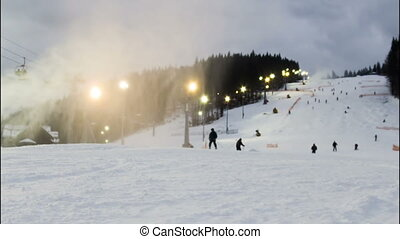 Night skiing at the ski slopes. Timelapse