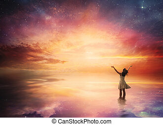 Night sky praise - Woman stands in praise before a beautiful...