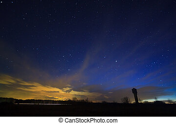 Night sky with clouds over the field