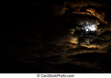 Night sky with full moon and beautiful clouds.