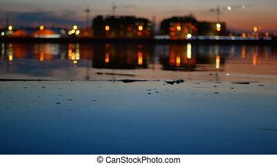 Night skyline river city - Night skyline reflected in water...