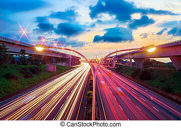 Night skyline view of city and highways with flowing traffic, Taiwan