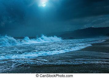 Night storm on Karon beach. Phuket Island in Thailand.