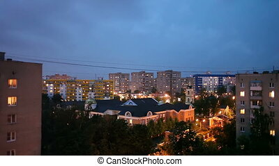 Night storm with lightning bolts over Odintsovo town. Russia.