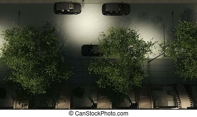 Night street buildings and moving cars top view - Top view...