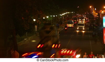 Night street - View of busy street at night. Time-lapse