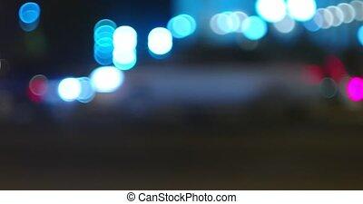 Night street traffic defocused side view