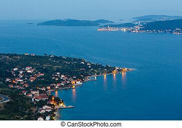 Night summer coastline and village on seashore (Pelješac peni