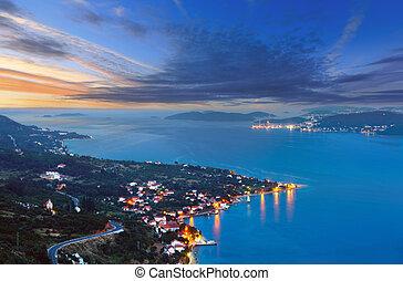 Night summer coastline and village  on seashore (Peljesac  peninsula, Croatia).