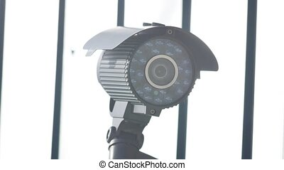 night surveillance camera on the building to protect against...