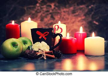 night table with mug and candle