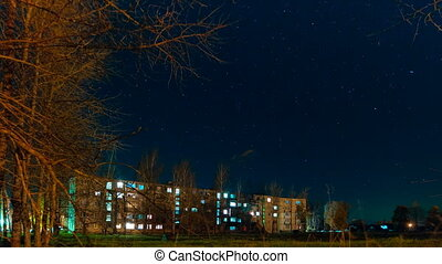 night the starry sky on houses time lapse