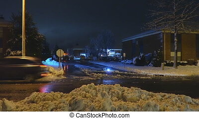 Night the tractor cleaning of snow with bulldozer after...