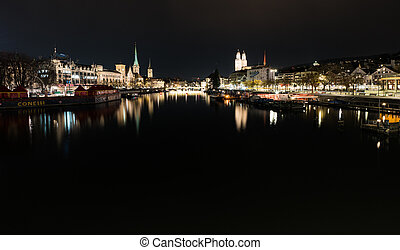 night time city skyline view of Zurich with the river Limmat