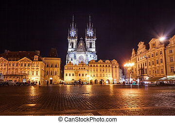 Night time illuminations of the magical Old Town Square in Prague, visible are Kinsky Palace and gothic towers of the Church