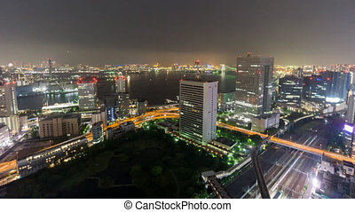 Night Time-Lapse of downtown in Tokyo with trains