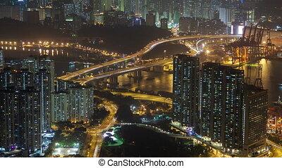 Night time-lapse traffic in Hong Kong. pan up