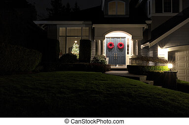 Night time view of a home decorated for the Christmas holiday