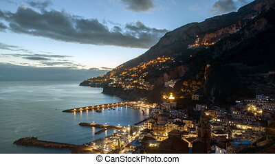 Night timelapse of Amalfi in Amalfi Coast, Italy - Aerial...
