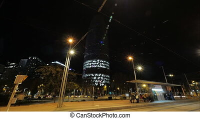 Night timelapse of Barcelona with illuminated Torre Agbar, ...
