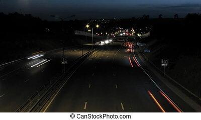Night timelapse scene of car traffi