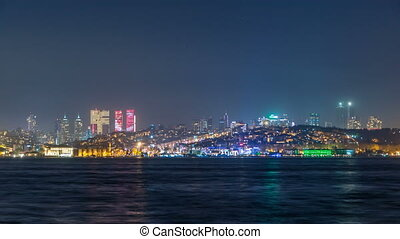 Night timelapse view of besiktas district in istanbul taken from asian part of the city.