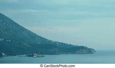 Night to day time lapse of famous island Sveti Stefan in...