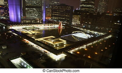 Night in the Toronto city center with a view of city hall