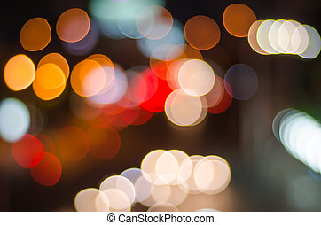 Night traffic and lights bokeh of car on road in city