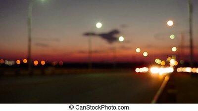 Night Traffic defocused footage, commuters cars on its way...