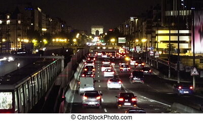 Night traffic in Paris. Busy street with plenty of cars....