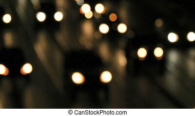 Night traffic lights bokeh - Soft focus shot of approaching...