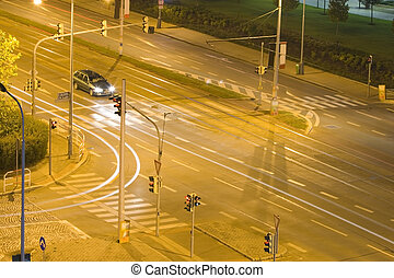 night traffic on a crossroad in the city of Prague