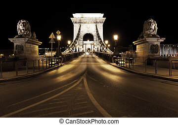 Night traffic of cars on Secheni Bridge through Danube in Budapest