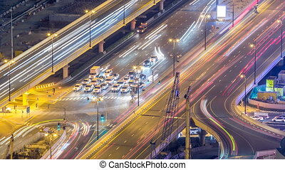 Night traffic on a busy intersection at Dubai downtown...