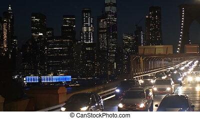 Night traffic on Brooklyn Bridge in New York City, New York,...