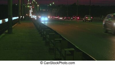 night traffic on overpass and two children on small bicycles...