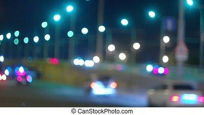 Night traffic on overpass, commuters cars defocused footage