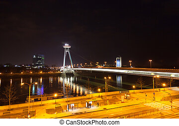 Night traffic on the bridge across the Dunai in Bratislava,...