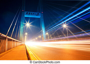 night traffic on the highway bridge