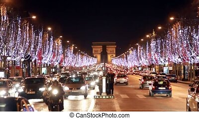 Night traffic on the road near the Arc de Triomphe - night...