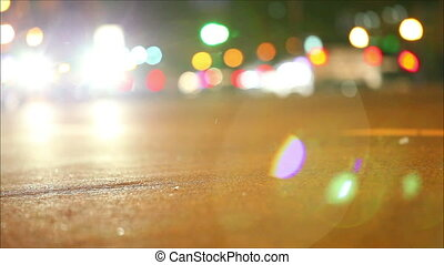 Night traffic , shallow depth of field. Road with cars in the background