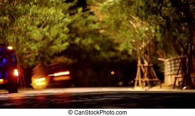 Night traffic with a slow shutter speed and crowd of people...