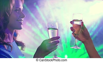 Night Trance - Two girls drinking champagne in the club and...